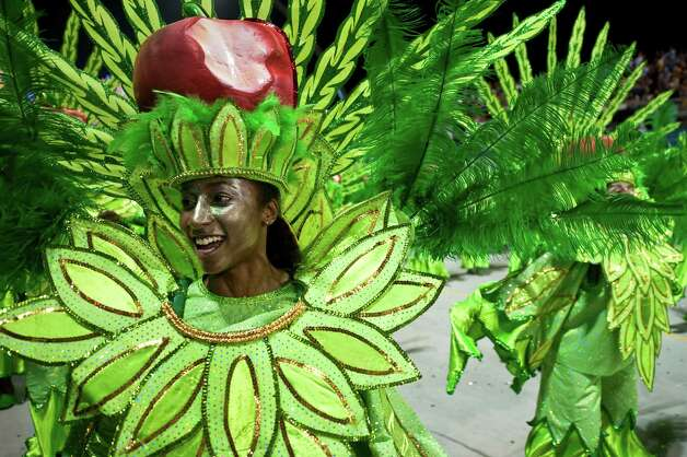A reveler of Tom Maior samba school performs during the second night of Carnival parades at the Sambadrome on Sunday in Sao Paulo, Brazil. Photo: NELSON ALMEIDA, Getty / 2013 AFP