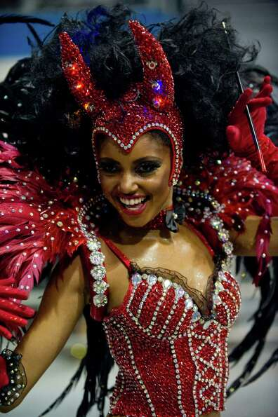 A reveler of Tom Maior samba school performs during the second night of Carnival parades at the Samb