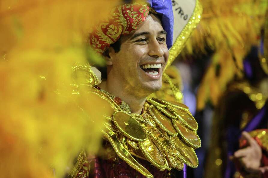 Members of the samba school Gavioes da Fiel dance during the second day of carnival parade at the An