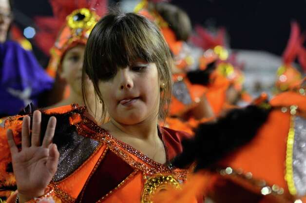 Members of the samba school Gavioes da Fiel dances during the second day of carnival parade at the Anhembi Sambadrome on Sunday in Sao Paulo, Brazil. Photo: Getty