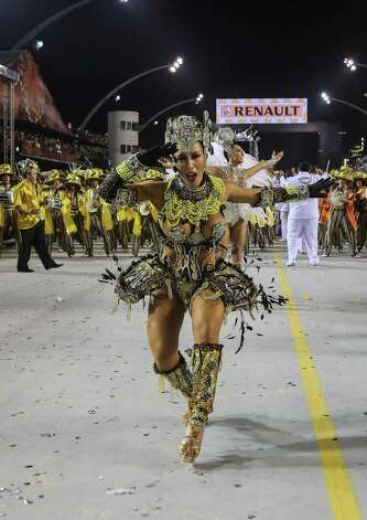 Members of the samba school Gavioes da Fiel dance during the second day of carnival parade at the Anhembi Sambadrome on Sunday in Sao Paulo, Brazil. Photo: Getty