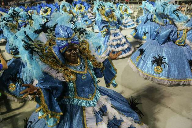 Members of the samba school Nen de Vila Matilde dance during the second day of carnival parade at the Anhembi Sambadrome on Sunday in Sao Paulo, Brazil. Photo: Getty