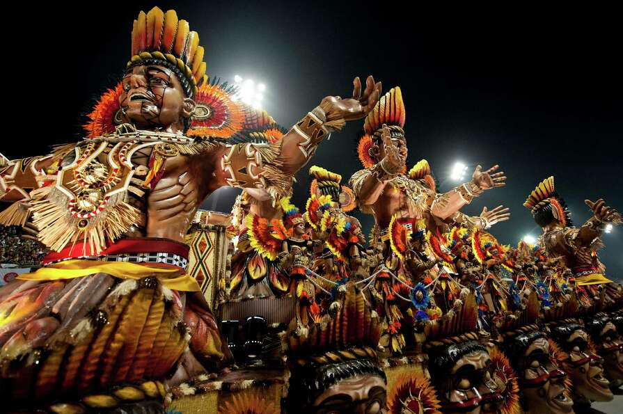 Revelers of Gavioes da Fiel samba school perform atop a float during the second night of Carnival pa