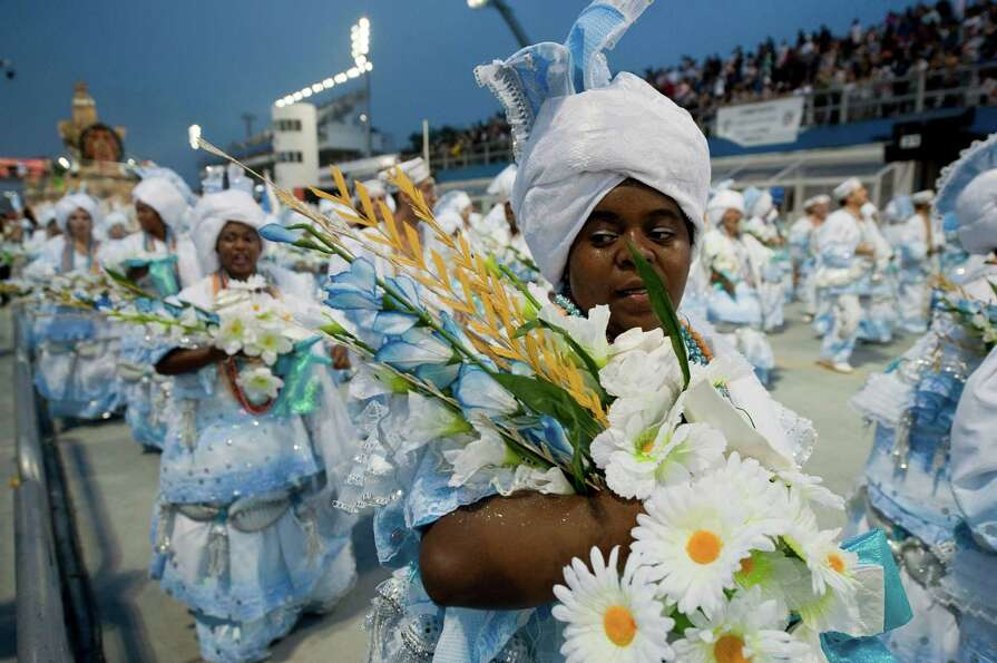 Revelers of Imperio de Casa Verde samba school perform during the second night of Carnival parades a