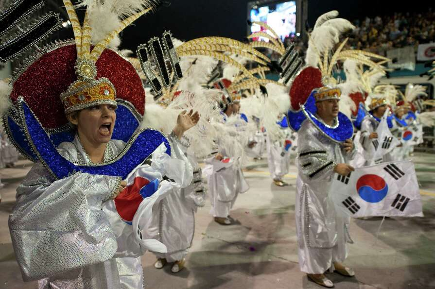 Revelers of Unidos de Vila Maria samba school perform during the second night of Carnival parades at