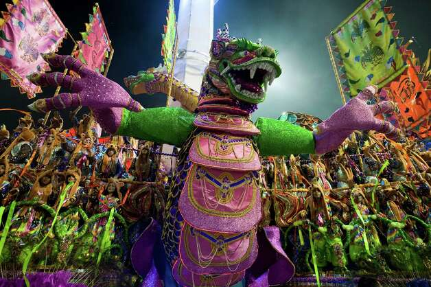 Revelers of Unidos de Vila Maria samba school perform atop a float during the second night of Carnival parades at the Sambadrome on Sunday in Sao Paulo, Brazil. Photo: NELSON ALMEIDA, Getty / 2013 AFP