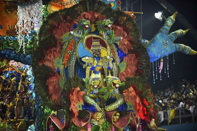 A reveler of Unidos de Vila Maria samba school perform atop a float during the second night of Carnival parades at the Sambadrome on Sunday in Sao Paulo, Brazil. Photo: NELSON ALMEIDA, Getty / 2013 AFP