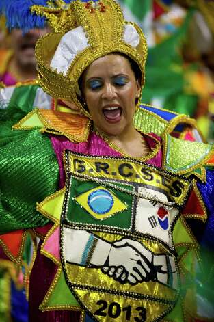 A reveler of Unidos de Vila Maria samba school performs during the second night of Carnival parades at the Sambadrome on Sunday in Sao Paulo, Brazil. Photo: NELSON ALMEIDA, Getty / 2013 AFP