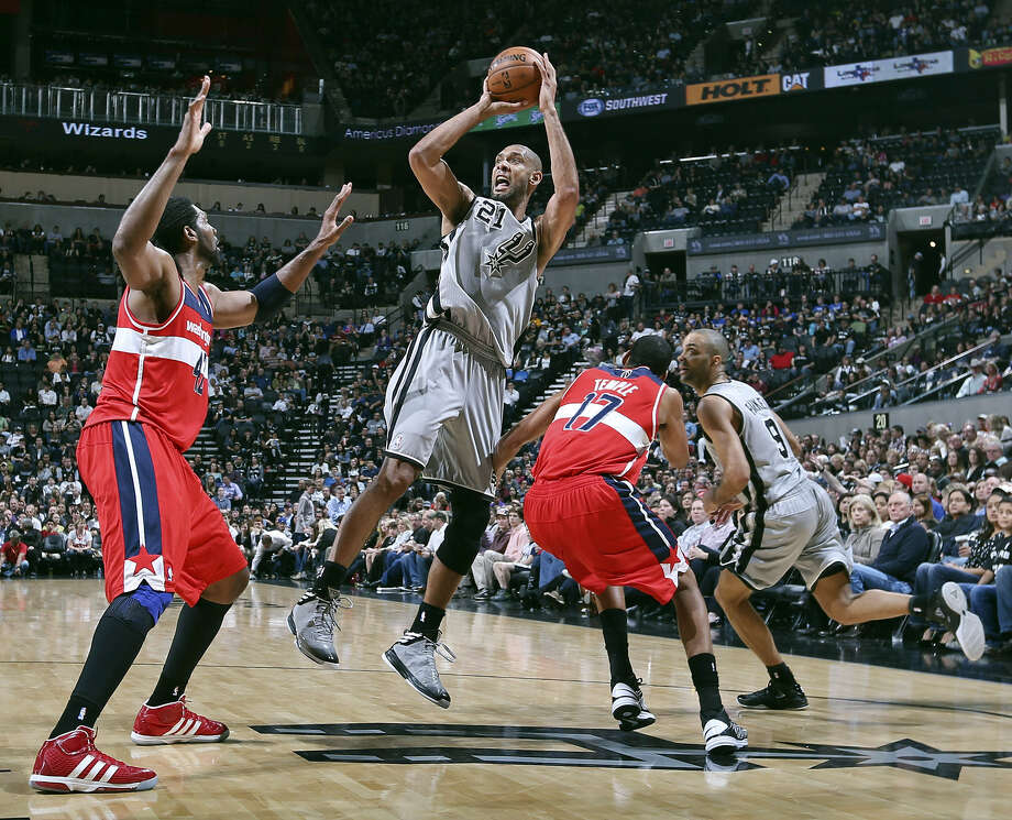 The Spurs' Tim Duncan, shooting Saturday vs. the Wizards, later suffered a sore left knee and mild right ankle sprain. Photo: Edward A. Ornelas / San Antonio Express-News