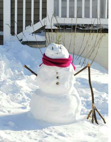A snowman stands in front of a house on Rocky Glen Road in Danbury Sunday, Feb. 10, 2013. Photo: Michael Duffy / The News-Times