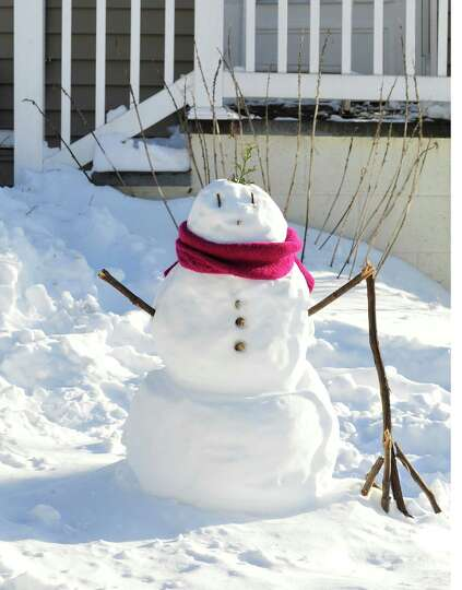 A snowman stands in front of a house on Rocky Glen Road in Danbury Sunday, Feb. 10, 2013.