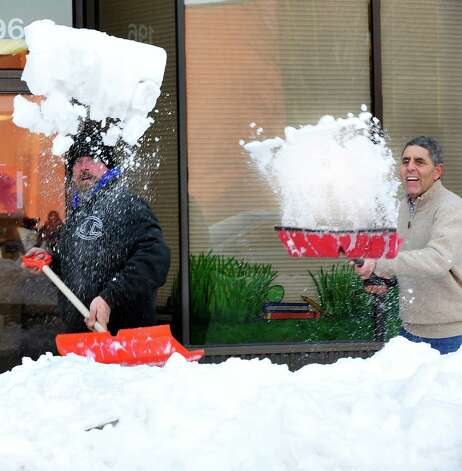 Charlie Hall, left, and Carl Bailey, shovel out of the snow in Danbury Sunday, Feb. 10, 2013. Photo: Michael Duffy / The News-Times