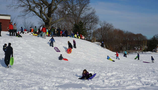 Plenty of sledding action Sunday on the grounds of Kings Highway Elementary School, but as of later afternoon, Westport school officials had yet to announce wether classes would be in session Monday.  WESTPORT NEWS, CT 2/10/13 Photo: Paul Schott / Westport News