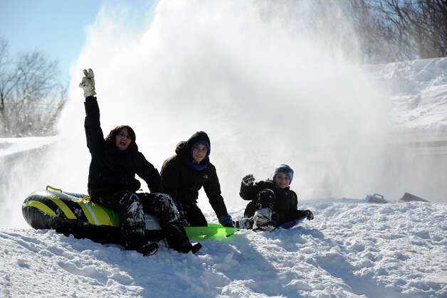 From left, Riley Webb, 11, Joe Monte, 10, and Chris Monte, 7, have fun on a mountain a recently plowed snow in Stratford, Conn., Feb. 10th, 2013. Photo: Ned Gerard