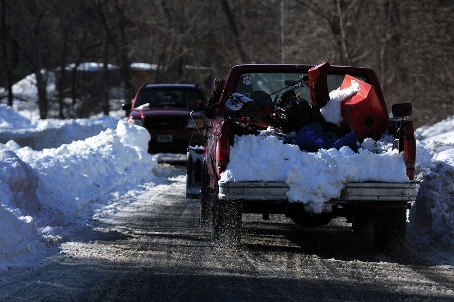 Only one lane of traffic has been plowed in the snow on Hawley Lane, in Stratford, Conn., Feb. 10th, 2013. Photo: Ned Gerard