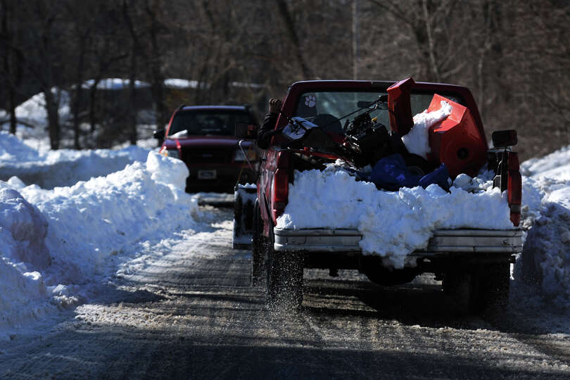 Only one lane of traffic has been plowed in the snow on Hawley Lane, in Stratford, Conn., Feb. 10th,