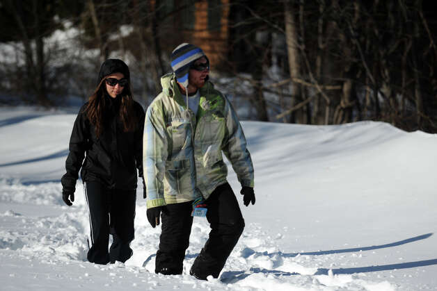 Michael Patria and Jessica Tumio walk in the snow on an unplowed section of Cutspring Rd., in Stratford, Conn., Feb. 10th, 2013. Photo: Ned Gerard