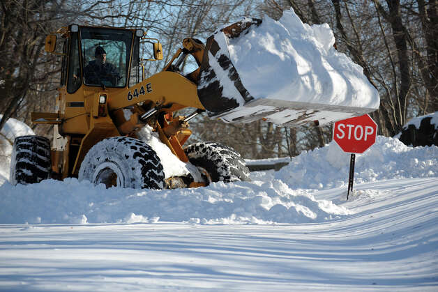 A tractor begins to remove snow from a section of Cutspring Rd., in Stratford, Conn., Feb. 10th, 2013. Photo: Ned Gerard