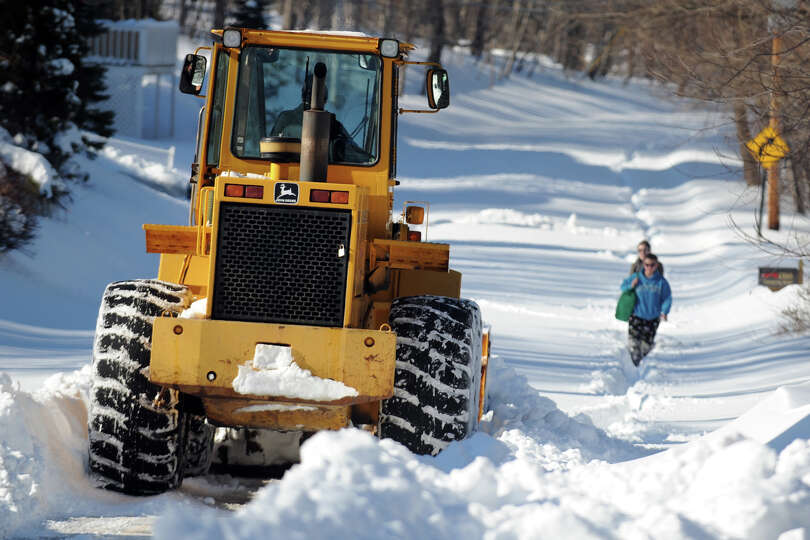 A tractor makes the first trip to remove snow from the north end of Cutspring Rd., in Stratford, Con