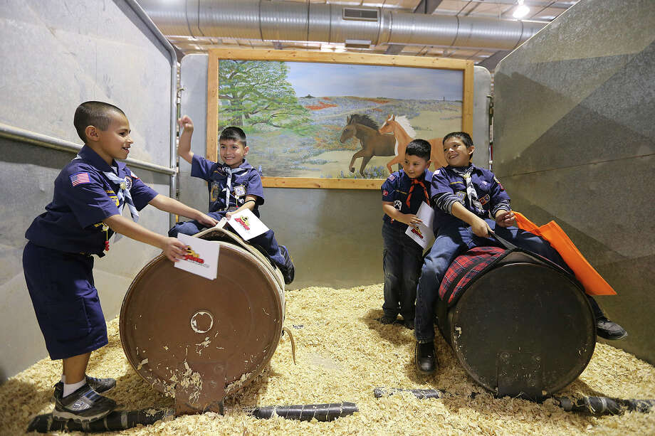 Windcrest Pack 157 Boy Scouts from left, Daniel Cortez, 8, Jimmy Cuin, III, 8, Julian Cuin, 6, and Nathan Rocha, 9, play around as they enjoy Boy and Girl Scouts Day at the San Antonio Stock Show and Rodeo, Sunday, Feb. 10, 2013. Photo: Jerry Lara, San Antonio Express-News / ©2013 San Antonio Express-News