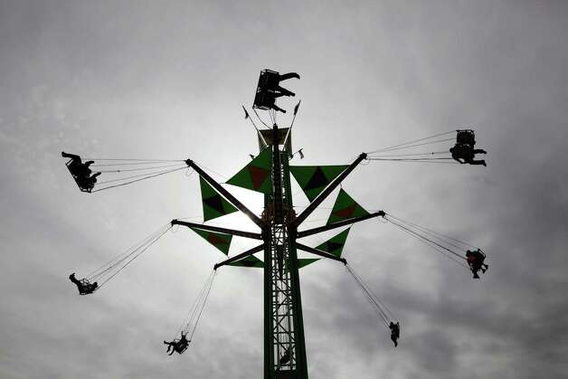 The public enjoys a ride at the carnival that is part of the San Antonio Stock Show and Rodeo, Sunday, Feb. 10, 2013. Photo: Jerry Lara, San Antonio Express-News / ©2013 San Antonio Express-News