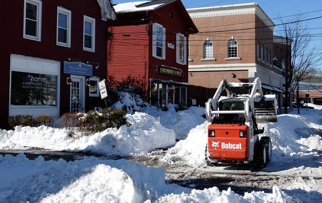 A Bobcat clears snow in front of stores near Firehouse Deli on Reef Road on Sunday afternoon. FAIRFIELD CITIZEN, CT 2/10/13 Photo: Mike Lauterborn / Fairfield Citizen contributed