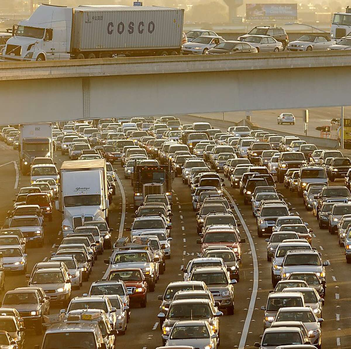 Traffic crawls towards the Bay Bridge toll plaza on Friday, Feb. 8, 2013, in Oakland, Calif. According to the Urban Mobility Report, the Bay Area ties Los Angeles for having the second-worst congestion in the country.