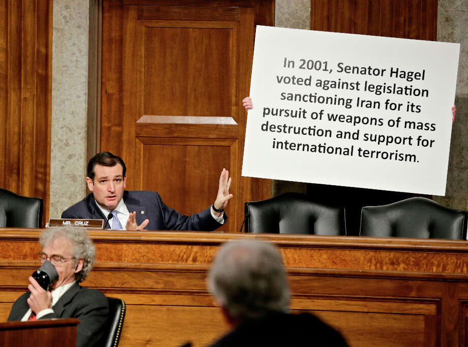 Sen. Ted Cruz, R-Texas, uses a poster while questioning Chuck Hagel, a former two-term GOP senator and President Obama's choice for defense secretary, during his confirmation hearing at the Senate Armed Services Committee on Capitol Hill in Washington, Thursday, Jan. 31, 2013. Hagel faced strong GOP resistance and was forced to explain past remarks and votes even as he appeared on a path to confirmation as Obama second-term defense secretary and the nation's 24th Pentagon chief. (AP Photo/J. Scott Applewhite) Photo: J. Scott Applewhite, Associated Press / AP