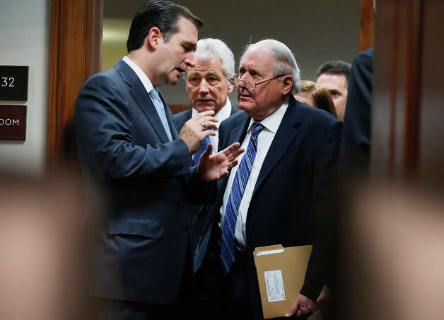 WASHINGTON, DC - JANUARY 31:  Senate Armed Services Committee member Sen. Ted Cruz (R-TX) (L) talks with committee Chairman Carl Levin (D-MI) (R) as they and former U.S. Senator Chuck Hagel (R-NE) arrive for Hagel's confirmation hearing to become the next secretary of defense on Capitol Hill January 31, 2013 in Washington, DC. President Barack Obama nominated Hagel, a controversial choice as Hagel opposed former President George W. Bush and his own party on the Iraq War and upset liberals with his criticism of a gay ambassador, for which he later apologized. Photo: Chip Somodevilla, Getty Images / 2013 Getty Images