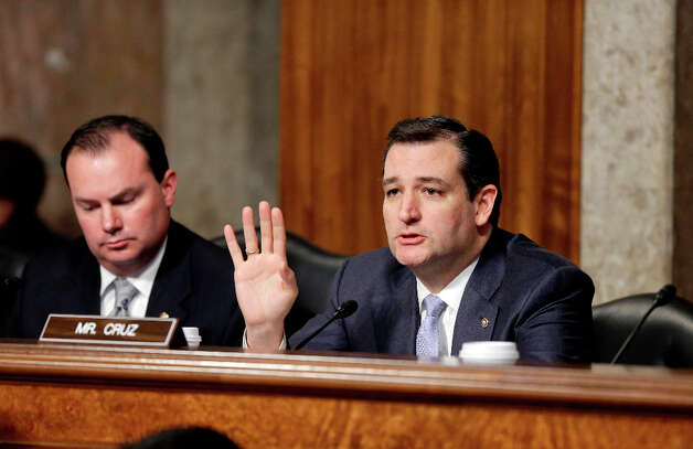 Sen. Ted Cruz, R-Texas, right, questions Chuck Hagel, a former two-term senator and President Obama's choice to be defense secretary, during his confirmation hearing at the Senate Armed Services Committee on Capitol Hill in Washington, Thursday, Jan. 31, 2013. Sen. Mike Lee, R-Utah, sits at left. Hagel faced strong GOP resistance and was forced to explain past remarks and votes even as he appeared on a path to confirmation as Obama second-term defense secretary and the nation's 24th Pentagon chief.   (AP Photo/J. Scott Applewhite) Photo: J. Scott Applewhite, Associated Press / AP