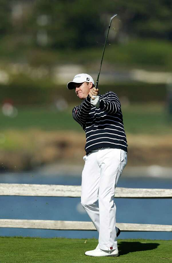 Jimmy Walker watches his tee shot on the seventh hole during the final round of the AT&T Pebble Beach National Pro-Am at Pebble Beach Golf Links on February 10, 2013 in Pebble Beach, California. Photo: Ezra Shaw, Getty Images / 2013 Getty Images