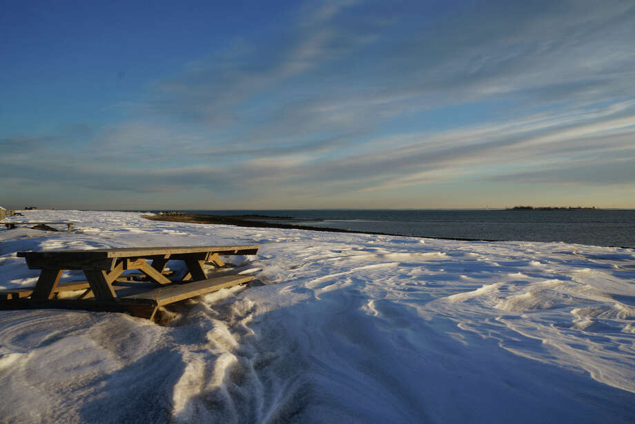 A cloud-swept sky over wind-sculpted snow covering Compo Beach heralds an overnight Sunday forecast of freezing rain, two days after a blizzard that dumped 3 feet of now on the region.  WESTPORT NEWS, CT 2/10/13 Photo: Paul Schott / Westport News