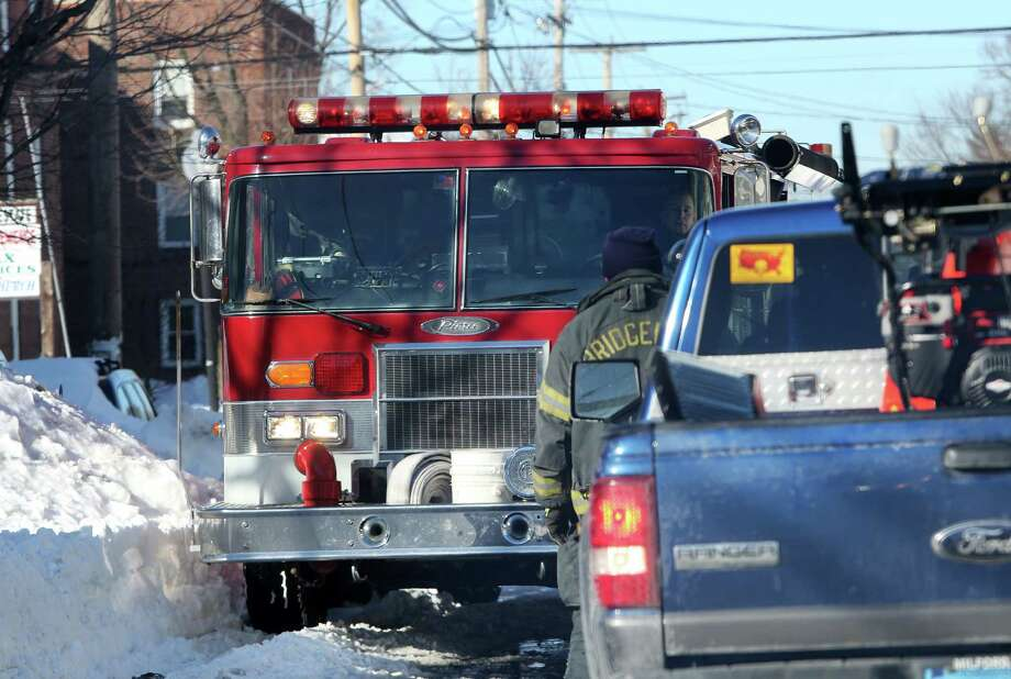 Mike Ross Connecticut Post freelance -Bridgeport firetruck attemping to get to a call gets stuck in traffic on East Main street on Sunday afternoon. City Officals are suggesting to residents please dont drive because of gridlock and  the ongoing snow removal clean-up Photo: Mike Ross / @www.mikerossphoto.com