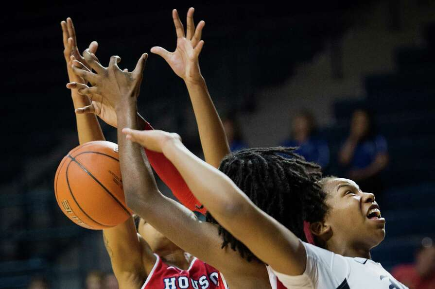 Rice forward Christal Porter, right, loses a rebound to Houston center Yasmeen Thompson during the f