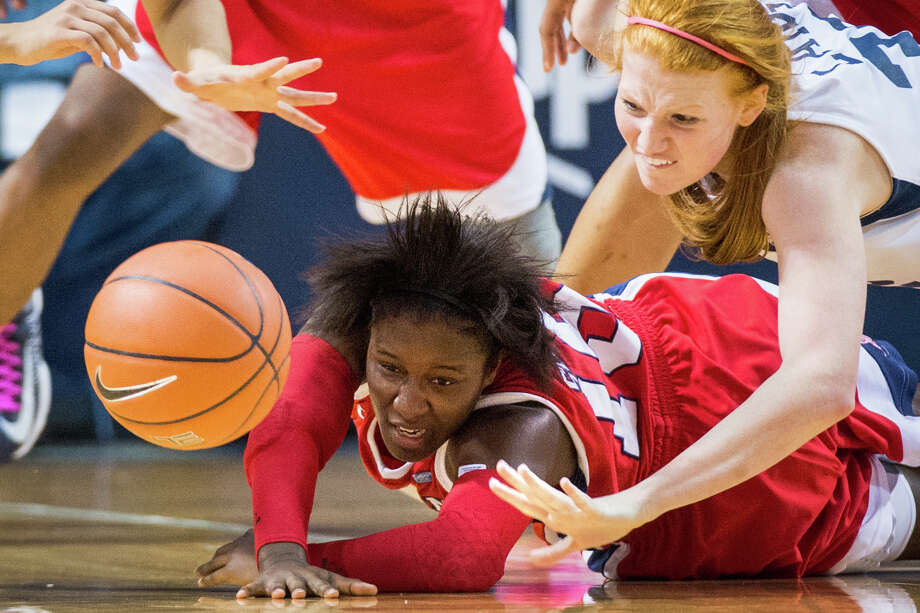Houston guard Alecia Smith (15) hits the floor chasing a loose ball against Rice forward Alyssa Lang (32) during the first half. Photo: Smiley N. Pool, Houston Chronicle / © 2013  Houston Chronicle