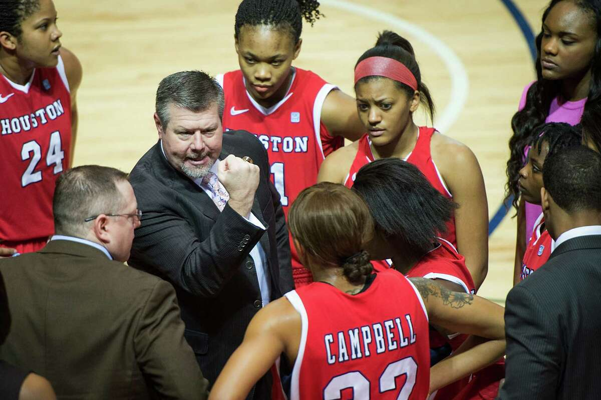 Houston head coach Todd Buchanan addresses his team during a timeout.
