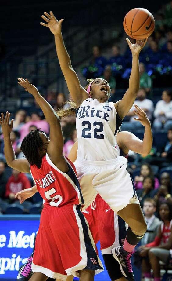 Rice guard Maya Adetula (22) drives to the basket past Houston guard Porsche Landry (5). Photo: Smiley N. Pool, Houston Chronicle / © 2013  Houston Chronicle