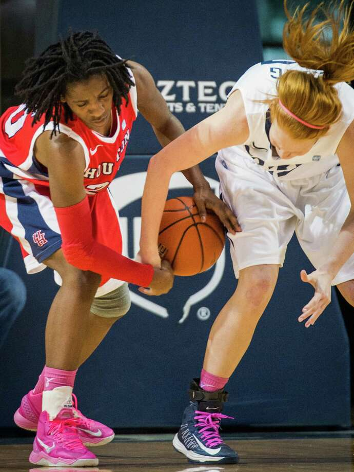 Houston center Yasmeen Thompson, left, fights for a loose ball with Rice center Alyssa Lang. Photo: Smiley N. Pool, Houston Chronicle / © 2013  Houston Chronicle