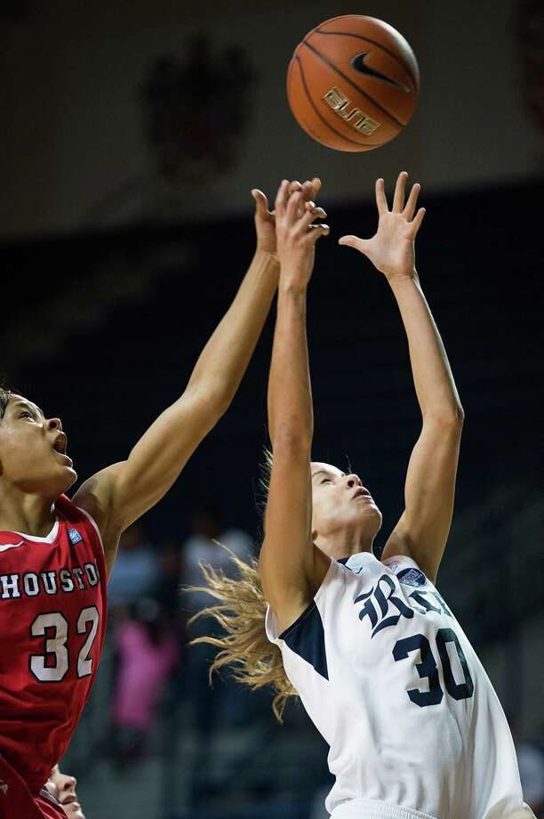 Houston forward Te'onna Campbell (32) knocks a rebound away from Rice forward Jessica Kuster (30). Photo: Smiley N. Pool, Houston Chronicle / © 2013  Houston Chronicle