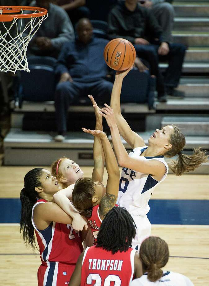 Rice forward Jessica Kuster (30) shoots over Houston forward Te'onna Campbell (32). Photo: Smiley N. Pool, Houston Chronicle / © 2013  Houston Chronicle