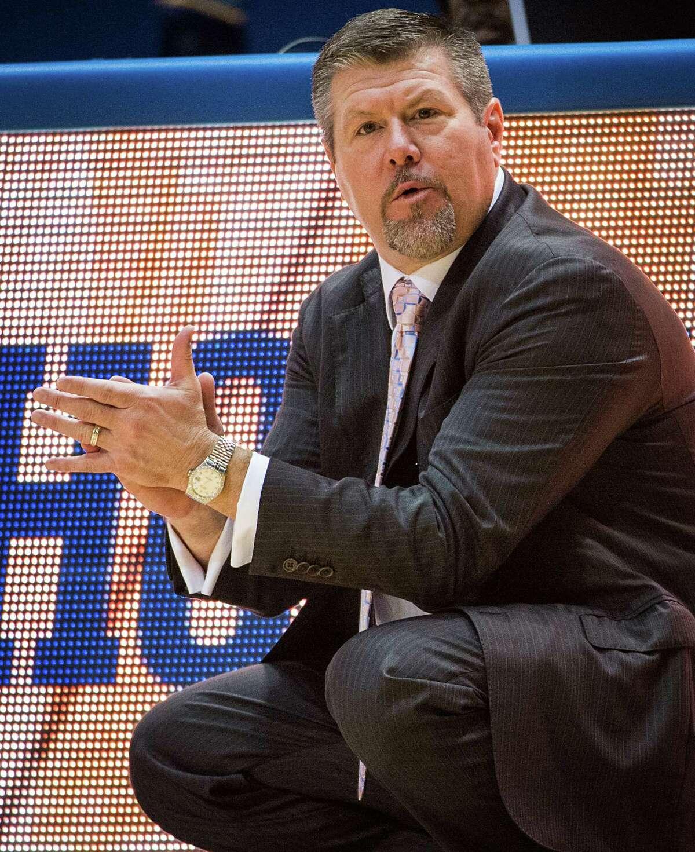 Houston head coach Todd Buchanan applauds a basket by his team.