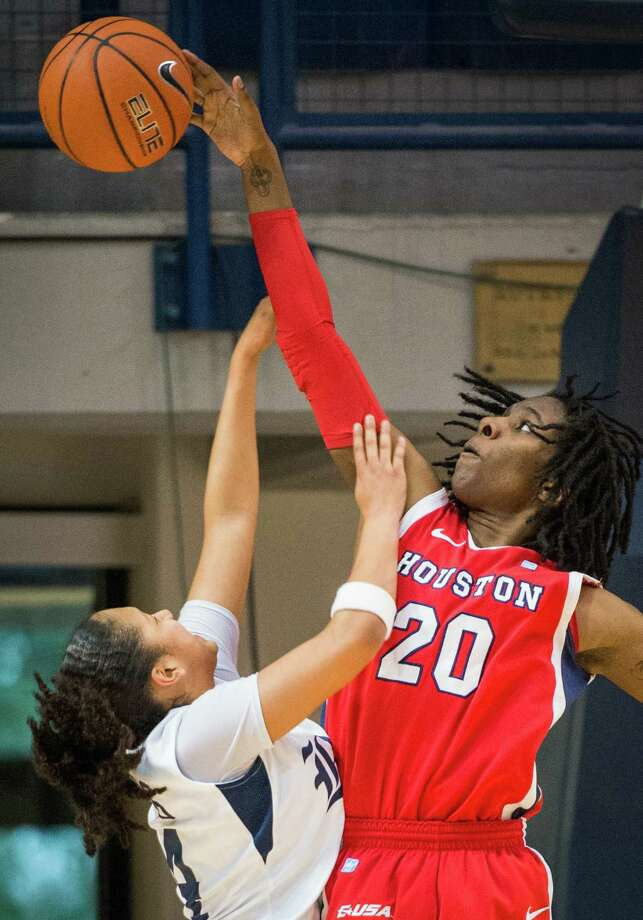 Houston center Yasmeen Thompson (20) blocks a shot by Rice guard Elena Gumbs (24) during the second half. Photo: Smiley N. Pool, Houston Chronicle / © 2013  Houston Chronicle