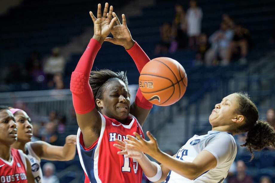 Rice guard Elena Gumbs fights for a rebound with Houston guard Alecia Smith. Photo: Smiley N. Pool, Houston Chronicle / © 2013  Houston Chronicle