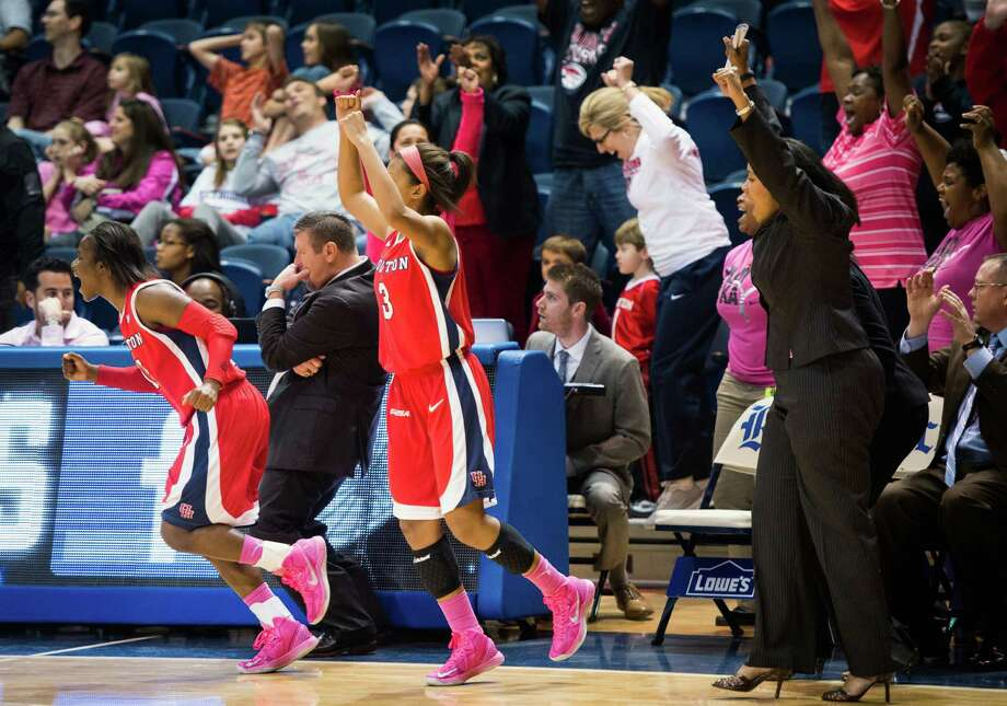 Houston guard Alecia Smith (15), head coach Todd Buchanan and guard Bianca Winslow (3) reacts at the final buzzer of their win over Rice. Photo: Smiley N. Pool, Houston Chronicle / © 2013  Houston Chronicle