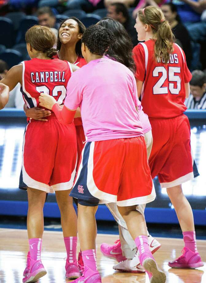 Houston forward Marche' Amerson, facing, hugs teammate Te'onna Campbell after the final buzzer of their win over Rice. Photo: Smiley N. Pool, Houston Chronicle / © 2013  Houston Chronicle