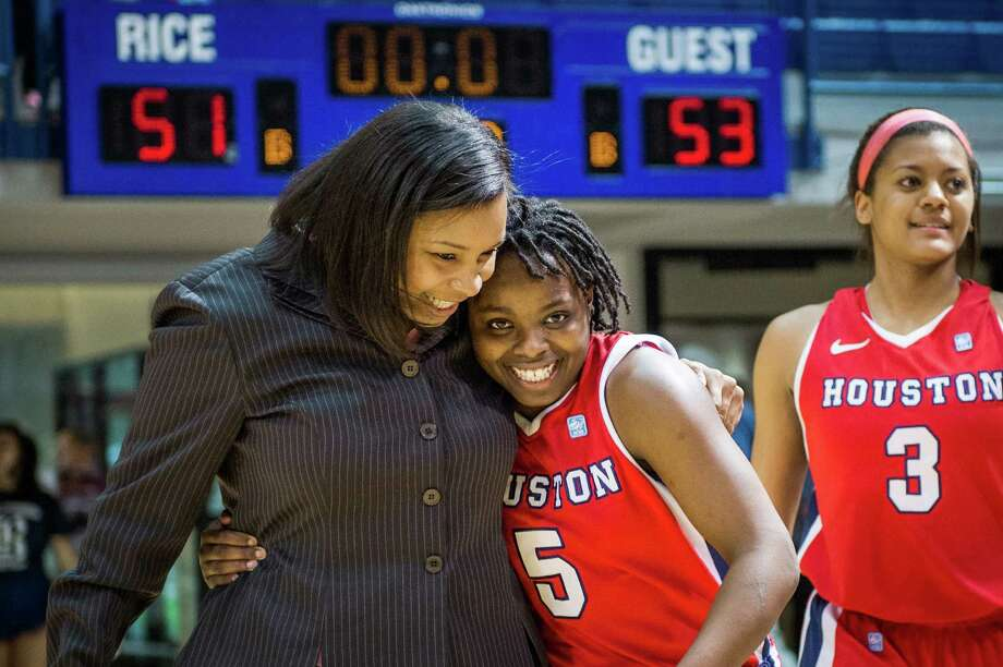 Houston guard Porsche Landry (5) celebrates with assistant coach Ravon Justice following a 53-51 victory over Rice. Photo: Smiley N. Pool, Houston Chronicle / © 2013  Houston Chronicle