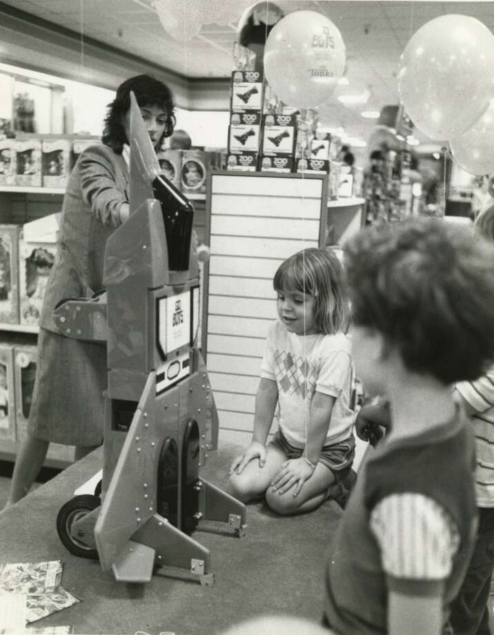 Keri Giesler, 5, talks to GoBot, the robot toy. Produced by Tonka Toys, GoBots can be transformed from cars, planes and other vehicles into little robots.Published Aug. 6, 1984 Photo: Buster Dean, Chronicle File
