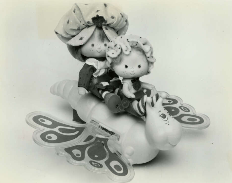 Strawberry Shortcake, the winsome character first seen on greeting cards, is the most popular toy this Christmas. Here, two are aboard one of many licensed accessories, Flitter-Bit.Published Nov. 29, 1981 Photo: Picasa, Chronicle File