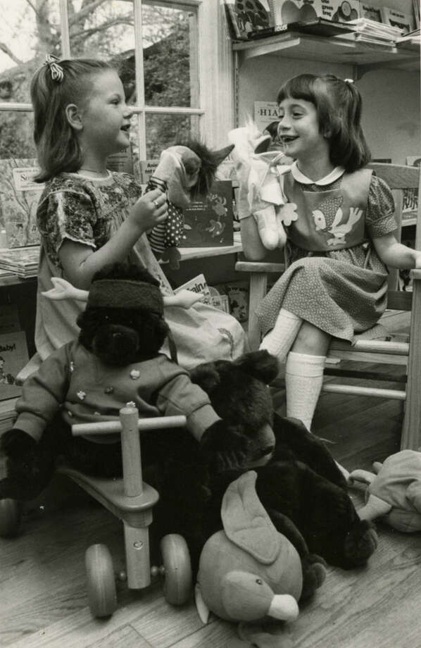 Stop, Look and Learn in the Village has a story hour for kids every Saturday morning. Here, Sara Kate Goodwin, left, and Laura Moser, both 6, play with puppets in the store s book room.Published March 24, 1984 Photo: Carrie Beth Tucker, Chronicle File
