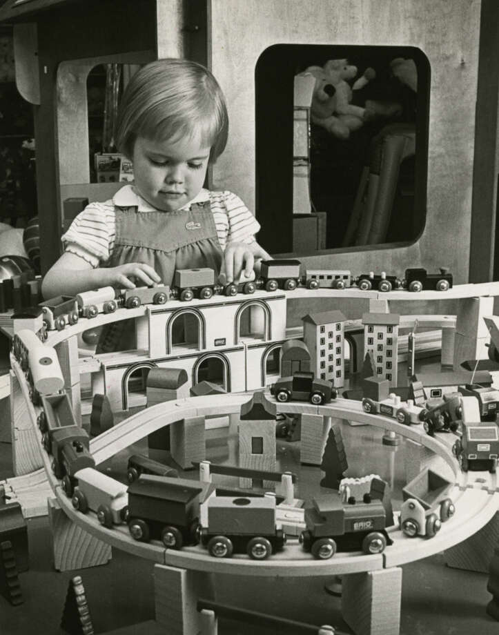 Wooden Brio toys, like this train set, aren t quite household words yet, but they re catching on. Here, Julie Quale (or Quayle), 4, plays with the Swedish-made Brio set at Splendid Childhood in Memorial.Published March 24, 1984 Photo: E. Joseph Deering, Chronicle File